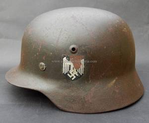 4052de6cecc A nice worn M40 single decal Luftwaffe helmet. The helmet is a Quist and is  size 62. The lot number is  DN 92. It has it s original leather chin strap.